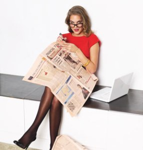 0507-woman-reading-newspaper_at